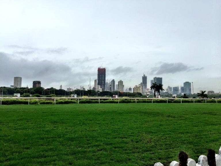 The Mumbai skyline framed by a grey, overcast blanket