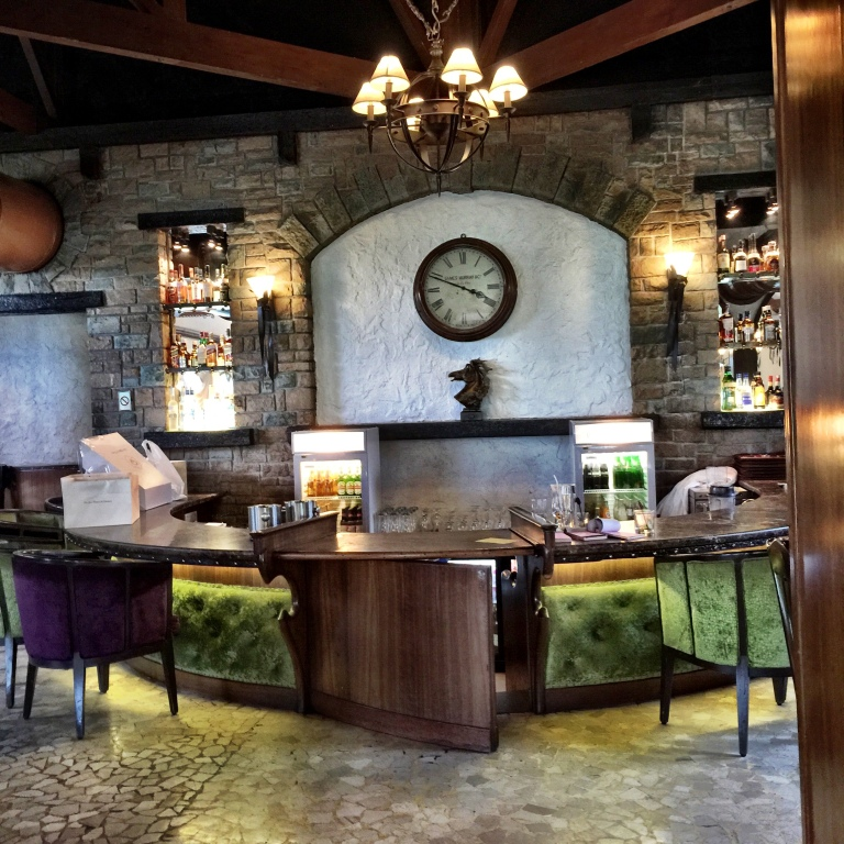 The bar area with a stony facade. A kick back in terms of design aesthetics