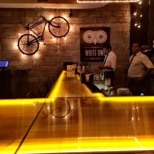 Bar area with the vintage style cycle in the distance