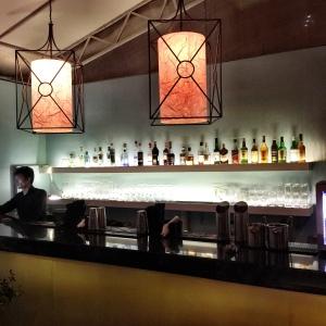 The dimly lit bar area